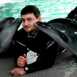 dolphin therapy specialist Dmitri Kogut, photo